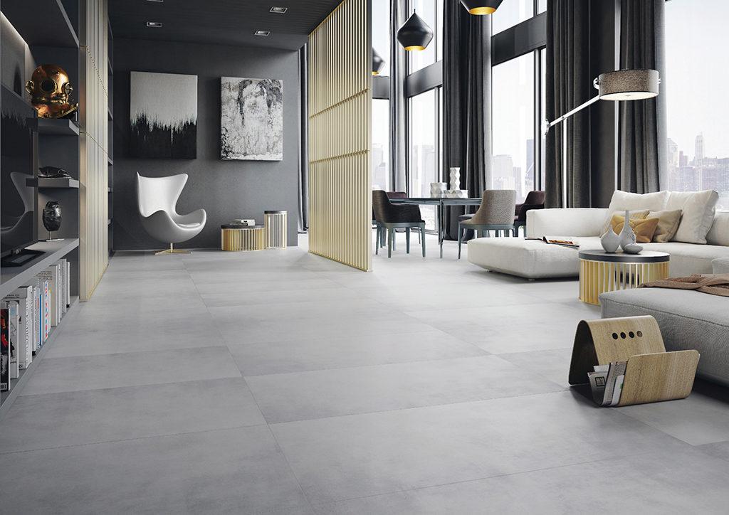 Nowoczesny salon z płytkami imitującymi beton na podłodze