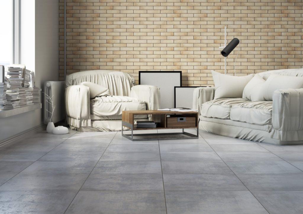 przestronny salon z beżową cegłą i podłogą betonopodobną
