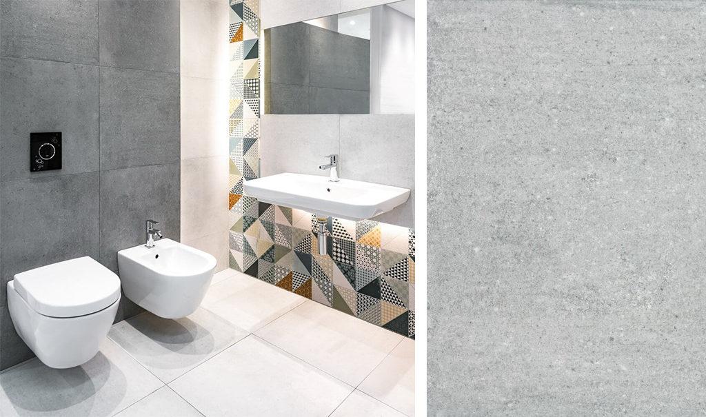 Jasnoszara imitacja betonu w łazience z kolorowym patchworkiem