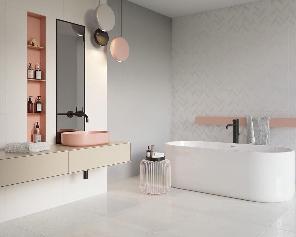 Delikatna łazienka w szarości, bieli i różu z płytkami 3D przy wannie